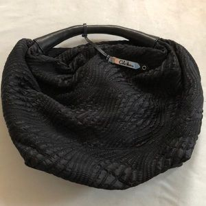 Cole Haan purse offers welcome